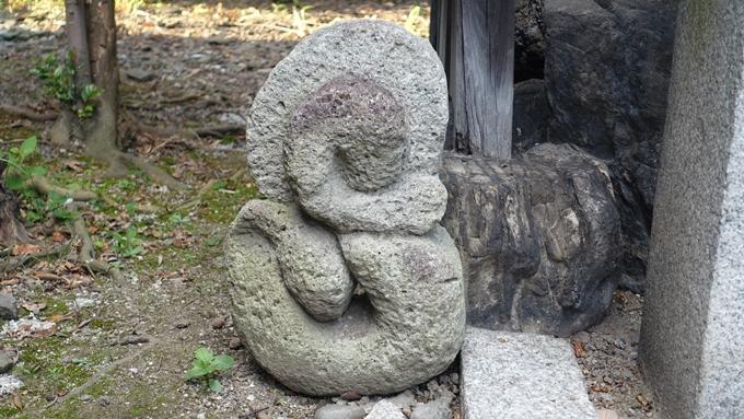 文子天満宮 妙見さんの巳の石像